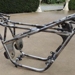 The bare frame made from exhaust tubing and Nicel Bronze welded using a fluxer. (The fluxer is the only way to go).